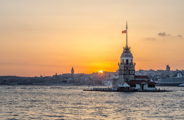 sunset behind maiden tower in turkish capital istanbul.