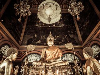 Golden Buddha and monk