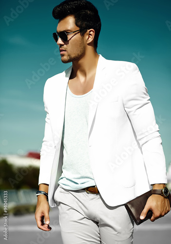 Fashion portrait of young sexy handsome model man in casual white ...