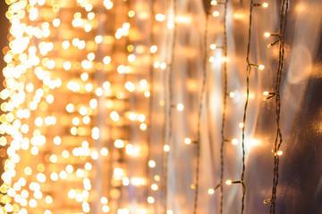 Christmas garland, gold bokeh