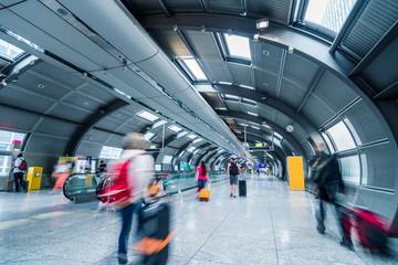 Blurred people in a futuristic walkway
