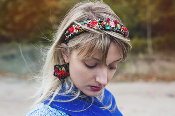 Autumn portrait of the woman in a headband and the Spanish earrings