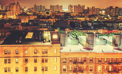 Retro toned Harlem neighborhood at night, NYC, USA.