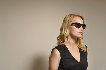 Blonde woman with black sunglasses