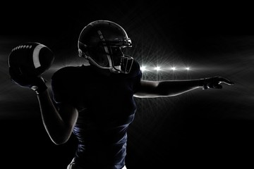 Composite image of silhouette american football player throwing ball