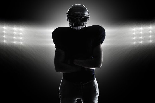 Composite image of silhouette american football player standing