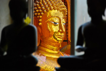 image of gold color buddha is back of black color buddha