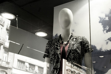 Female mannequins, black and white effect, fashion store, with natural double exposure