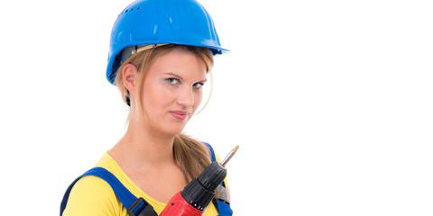 frau in arbeitskleidung mit akkuschrauber
