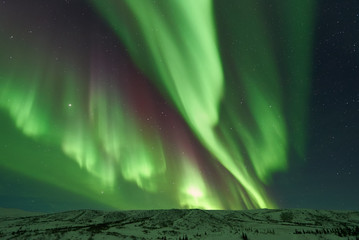 Aurora Borealis Northern Lights snowcapped mountains