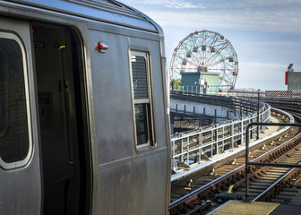 Stopped train in an elevated subway station overlooking Coney Island in Brooklyn, New York