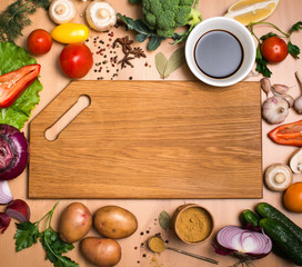 Cutting board, vegetables, herbs and spices. Colorful ingredient