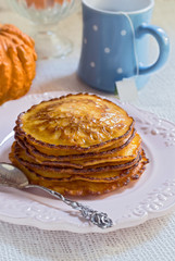 Pumpkin pancakes on vintage plate. Decorated an entire pumpkin.