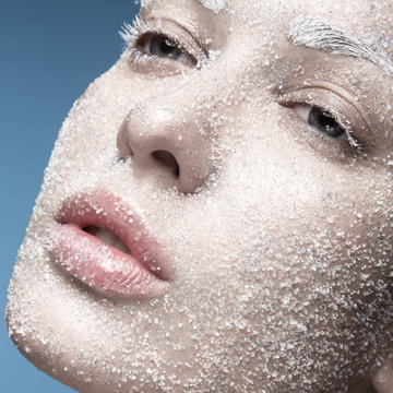 Portrait of girl with pale skin and sugar snow on her face
