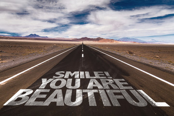 Smile! You Are Beautiful written on desert road