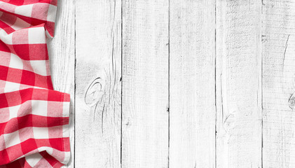 red picnic tablecloth on white wood table background Wall mural