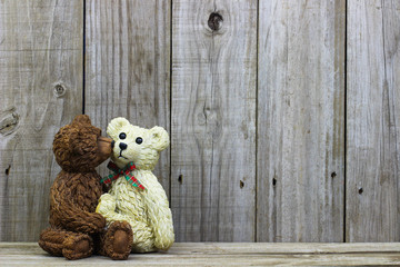 Teddy Bears kissing with rustic wood background