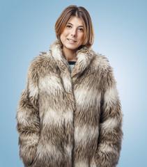 beautiful young woman wearing a fur coat