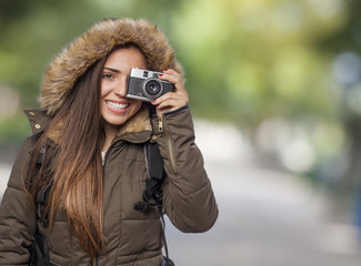 beautiful young woman hiker taking a photo with the camera