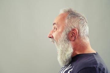 screaming senior man with grey-haired beard