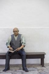 Sculpture of Sarmiento sitting on a bench and ready a book at the Casa Natal de Sarmiento Museum. San Juan. Argentina 2014