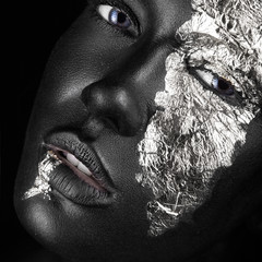 Foto op Aluminium People fashion portrait of a dark-skinned girl with silver foil make-up. Beauty face.
