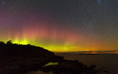 Northern lights over the sea, the starry sky, Finland, Aland Islands