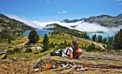 Girl hiker enjoying Panorama of Neouvielle mountain Massif