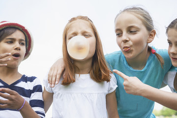 Girls playing with bubble gums, Bavaria, Germany