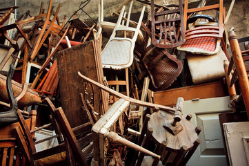 Wooden chairs and vintage chairs, thrown into the street