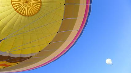 Colorful hot air balloon against blue sky. Shot taken on a hot air balloon ride during sunrise at Cappadocia, Turkey.