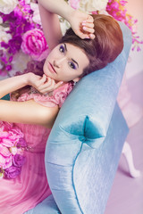 vintage style sensual portrait of beautiful woman on the couch