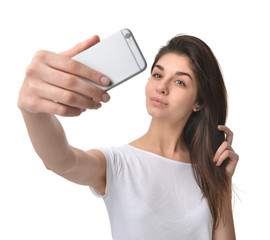 Young pretty woman make self portrait selfie with her cellphone