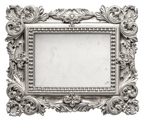 Silver picture frame with grungy canvas. Vintage baroque object