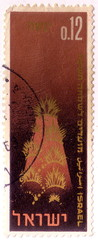 A stamp printed in Israel shows symbolic representation of the land, the Creation, as described in Genesis, chapter 1, circa 1965