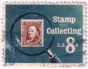 A stamp printed in USA shows Pictures magnifying glass over United States postage stamp, circa 1972