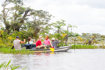 Boat With Tourists In Amazonian Jungle