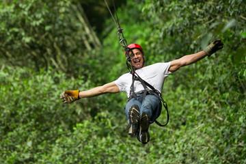 zip line ziplin adventure man adrenalin adult forest sports entertainment sport mature man on zipline ecuadorian andes zip line ziplin adventure man adrenalin adult forest sports entertainment sport