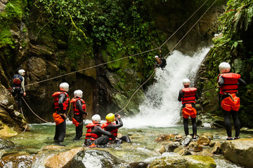 Team Of Mixed People On Canyoning Adventure Wall mural