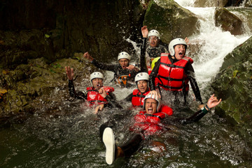 outdoor canyoning active group adventure water sport fun expedition river partnership of energetic teenage human during a canyoning expedition in ecuadorian rain forest outdoor canyoning active group