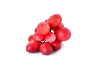 whole Carunda or Karonda fruit on white background