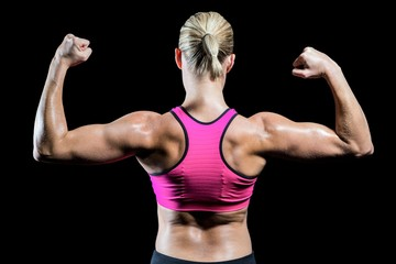 Muscular woman flexing her arms