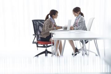 Two women talking in the office