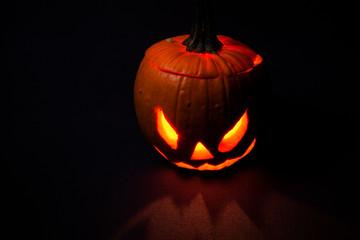 Hallween pumpkin on isolated dark red.Horizontal.