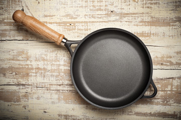 frying pan on aged wood