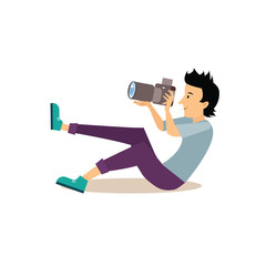 Sitting Photographer in Flat Style. Vector Illustration