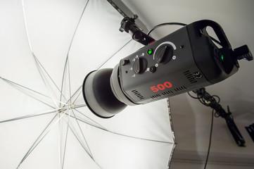 Photographic studio strobe lighting and reflective umbrella