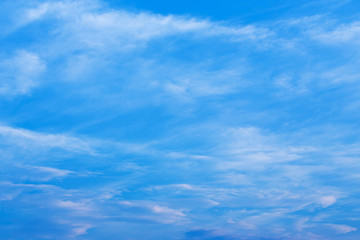 wind blows clouds in blue sky background