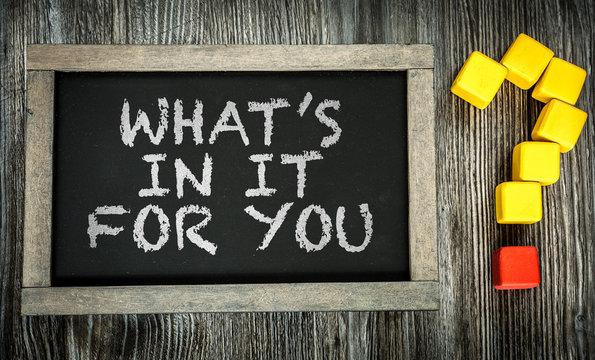 Whats In It For You? written on chalkboard