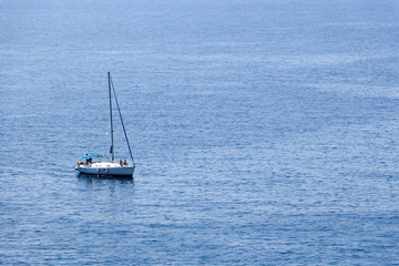 Deep blue sea seascape background with sailing boat.
